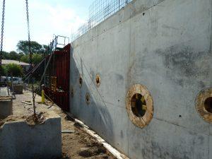 ecole-tabarly chantier mur façade avec fenêtres rondes